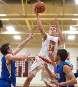 William Byrd High School's Evan Owens (14) goes up for a basket past Blacksburg High School players during the first round of the 3A West tournament at William Byrd High School. William Byrd won 67-60. (Erica Yoon/The Roanoke Times)