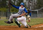 Fort Defiance's Bryce Miller collides with Wilson Memorial's catcher Ben Corbin before scoring the first run of their baseball game on Thursday, March 19, 2015. (Griffin Moores/The News Leader)