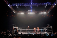 Myron Dennis, right, and Brian Collette, center, dance around the ring during Friday's SuperFight presented by Glory Sports International at the Hampton Coliseum. (Jonathon Gruenke/Daily Press)