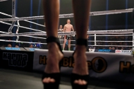 Robert Thomas waits inside the ring in between rounds as women carrying cardboard numbers to identify the current round pass by before the start of the match against Joe Schilling during Friday's co-headline event presented by Glory Sports International at the Hampton Coliseum. (Jonathon Gruenke/Daily Press)