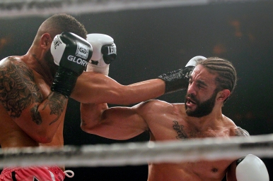 Myron Dennis, left, trades punches with Brian Collette, right, during Friday's SuperFight presented by Glory Sports International at the Hampton Coliseum. (Jonathon Gruenke/Daily Press)