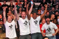 Fans of Raymond Daniels cheer as he competes against Jonatan Oliveira during Friday's tournament presented by Glory Sports International at the Hampton Coliseum. (Jonathon Gruenke/Daily Press)