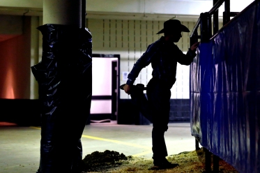 A bull rider stretches in the hallways of the Hampton Coliseum before competing in the Pro Bull Riders Blue DEF Velocity Tour Saturday evening. (Jonathon Gruenke/Daily Press)