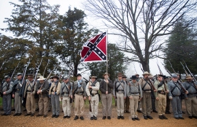 Re-enactors wait to march into the Appomattox Court House National Historic Park early Thursday morning for the reenactment of the Battle of Appomattox Court House during the 150th anniversary of the end of the Civil War. Re-enactors from all over the country and world came to Appomattox to celebrate the historic five day event participating in battles, camp life and educational programming.