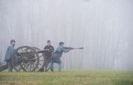 The Union Army loads a canon during battle with the Confederate Army during a re-enactment of the Battle of Appomattox Court House on Thursday morning during one of the real time events held at the National Park.