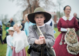 Lucas Woody and his sisters Lauryn (left) and Lainey of Appomattox watch the opening ceremonies for the 150th anniversary of the end of the Civil War on Thursday.