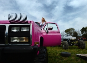 Baylee Hart steps up in her truck, which has matching eyelashes, to look over the mud hop course before the start of the Muddin' at the Moose event on Saturday, April 11, 2015. Hart would race in one run at the event before switching gears to attend her senior prom that night at nearby Broadwater Academy.