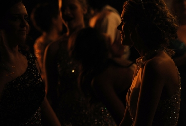 Baylee Hart (right) smiles as she talks with friends during the Broadwater Academy senior prom. Earlier in the day Hart competed in the local Muddin' at the Moose mud hop.