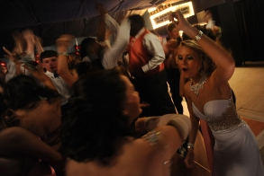 Baylee Hart (right) dances with her friends during the Broadwater Academy senior prom. Earlier in the day Hart competed in the local Muddin' at the Moose mud hop.