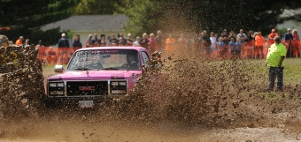 Baylee Hart participates in her first and only race in the Muddin' at the Moose mud hop in Belle Haven, Va. on Saturday, April 11, 2015. Hart, a high school senior, and the only female driver in the field that day, had to cut two races out for the day to switch gears and get ready for her senior prom that night.