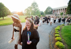 Hand in hand, Sweet Briar senior Charlotte Hopkins (right) and junior Nadirah Abdus-Sabur make their way around the quad during the yearly tradition of lantern bearing on May 6. Each senior picks an underclassman to make her a lantern. During the evening, the pair will walk around the quad three times symbolizing the years spent at the college before the seniors break off and take their final lap on their own. It was announced in March that Sweet Briar College, an all female college founded in 1901, would be shutting it's doors at the end of the school year after a vote to close to school was made by the board of directors. The all girls school was one rich with tradition and legacy. A somber feeling was present during these once joyous traditions as they would be experienced for the final time.