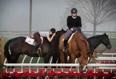 "Members of the Sweet Briar equestrian team pause between drills during an early-morning practice April 8. ""Not everyone has to do it but a lot of people chose to because of how fabulous our riding program is,"" said senior Jenny Mix."