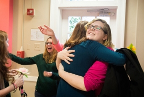 "Sophomore Tory Fairman hugs senior Amanda Gande after Fairman surprises Gande on April 16 by revealing she has been her ""secret sophomore"" for the year. Once a month, the sophomores leave presents for the seniors in the dining hall without revealing who they are from until the end of the year, helping to foster relationships between the classes."