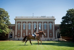 """Sweet Briar equestrian seniors on May 13 take part in the yearly tradition of senior ride, during which the students are allowed to take their horses on campus and run freely. """"It feels like the best way to end our year,"""" says senior Julie Moran."""
