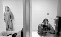 Newport News inmate Gregory Washington talks on the phone at the jail annex as he prepares for a GED graduation ceremony. Three inmates participated in the ceremony inside the jail.