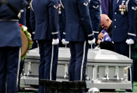 --General News 2nd Place: Mike Morones/Military Times--Steven R. Woods becomes emotional after receiving the flag for his father Army Staff Sgt. Lawrence Woods during a burial service on Friday, March 21, for seven service members who died on Oct. 24, 1964 near Bu Prang, Vietnam. The remains of Staff Sgt. Woods were recently identified though partial remains of six service members and the complete remains of an eighth crew member were recovered in 1964.