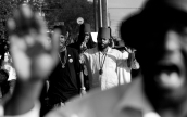 --General News HM: Rob Ostermaier/Daily Press--Khori Allende-El of the Moorish Science Temple of America marches with about forty peaceful protestors up Jefferson Ave. to the Newport News Police headquarters. The march was held to draw attention to the situation in Ferguson, Missouri and to gun violence in general.