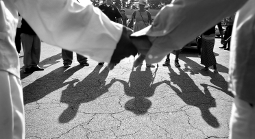 --Lifestyle HM: Rob Ostermaier/Daily Press--A group of about forty members of the community pray before a short protest march up Jefferson Ave. to Newport News police headquarters Wednesday as they try to draw attention to the situation in Ferguson, Missouri and the shooting of Michael Brown.