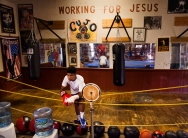 --Portrait 3rd Place: Griffin Moores/News-Leader--Kavon Robertson, who at 14-years-old has won six boxing championship belts, rests for a moment after a bout of hitting the punching bag at the Staunton Boxing Club on Wednesday, Sept. 10, 2014. Robertson is training for the chance to fight with the the U.S. Junior Olympic team in January.