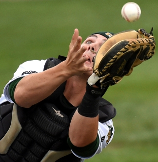 Lynchburg Hillcats catcher Joe Odom makes an out early in a game between the Hillcats and the Winston-Salem Dash Friday night August 8, 2014 at City Stadium in Lynchburg.