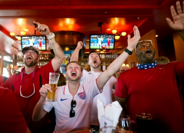"--Sports Feature 1st Place: Kaitlin McKeown/Daily Press--Tim Whitlock, Connor Stevenson, Everette Johnson and River Cypress react to a play while watching the first half of the United States versus Ghana World Cup game on Monday at Park Lane Tavern in Hampton. Stevenson described the game watching atmosphere as festive but tense. ""It's pretty much the best time you can ever have but it's also nerve-wracking,"" he said. ""Everybody supports America, and that's what it's about. We're all coming together for it."""