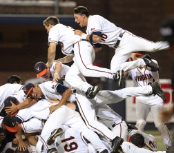 --Sports Feature HM: Kevin Morley/Richmond Times-Dispatch--UVA Cavaliers celebrate after defeating the Maryland Terrapins in the NCAA Super Regional at UVA, 11-2, June 9, 2014.