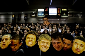 --Sports Feature HM: Stephanie Klein-Davis/Roanoke Times--Radford High School fans supported their team on Saturday in the VHSL Group 1A West Championship against Altavista High School. Sharon Jones, mother of player, Nate Jones had the poster heads printed of the team. (30)Altavista won 49-44. Photo taken March 15, 2014.