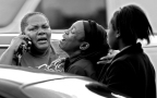 --Spot News 3rd Place: Rob Ostermaier/Daily Press--Friends and family of stabbing victim Taiwo Douglas-Wells react to the news that he had died from his wounds sustained in an attack behind Newsome Park Elementary School.