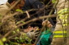 --Spot News HM: Griffin Moores/The News & Advance--An injured driver who crashed his drilling rig through a guard rail along I-64 screams as rescue workers attempt to remove him from an embankment in Waynesboro on Sept. 24, 2014.