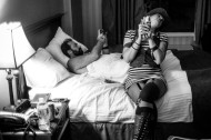 LANCASTER, PA - OCTOBER 3: Back in their hotel room, Phillip Roebuck, left, checks his email on his smartphone while his wife Phoenix Roebuck, right, enjoys a microwaved burrito from a gas station after a performance at The Chameleon Club in the early hours of Friday, Oct. 3, 2014 in Lancaster, Penn. Roebuck opened up for The Devil Makes Three for two nights on their tour.