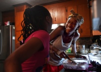 Promise and Sahara share a laugh while preparing blackberry cobbler with fresh berries they picked earlier that morning at Morris Orchard in Monroe, Va.