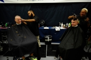 Zachary Wesemsnn, left, and Mitchell Perry get their hair cut as plebes of the class of 2018 arrive for Induction Day at the US Naval Academy in Annapolis, Md., on Tuesday, July 1, 2014.