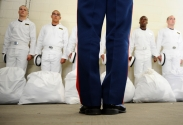 Plebes listen to instructions during Induction Day at the US Naval Academy in Annapolis, Md., on Tuesday, July 1, 2014.