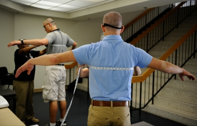 Incoming plebes get measured for uniforms during Induction Day at the US Naval Academy in Annapolis, Md., on Tuesday, July 1, 2014.