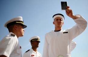 Midshipmen 1st Class Eric Viscardi, left, Charles Parker Jordan, working as detailers on Induction Day, inspect plebes at the US Naval Academy in Annapolis, Md., on Tuesday, July 1, 2014.