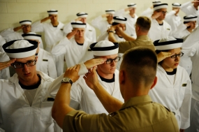 Marine second lieutenants correct plebes as they learn to salute properly on Induction Day at the US Naval Academy in Annapolis, Md., on Tuesday, July 1, 2014.