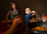 """Matthew stretches his """"narm,"""" a nickname he created as a mix between """"nub"""" and """"arm,"""" while making holiday treats alongside his cousin Tori Critzer."""