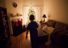 Looking for his Elf on the Shelf, Matthew walks through his family's living room at their home in Fishersville.