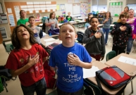 Matthew says the Pledge of Allegiance before homeroom class at Wilson Elementary School. One of his dream's is joining the military to drive trucks, fly jets or work with computers.