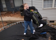 Matthew wrestles with his cousin Patrick Henderson on a chilly afternoon in Waynesboro.