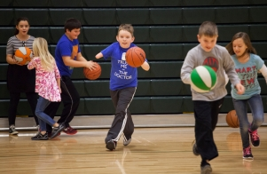 "Matthew dribbles a basketball during gym class at Wilson Elementary School. Although there have been moments of anxiety for Matthew concerning how he's being perceived by classmates, ""They treat me like IÕm one of them,"" he said."