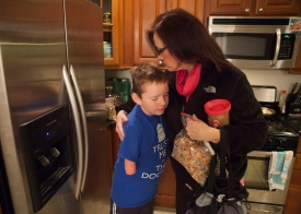 "Matthew hugs his mom Lori Mitchell as she gets ready to leave for work early in the morning. One of the first things Lori will tell you about her son is that ""can't"" is a word he's not allowed to use."