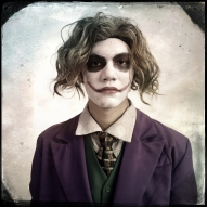"Elvis Brown, 18, cosplays as the Joker. Whitehurst said ""My favorite DC character is Joker so why not dress like him? Harley is my girlfriend's favorite character anyway."""