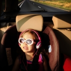 Despite a push to move away from technology while on the road my daughter, Opal Facun, 3, watches a movie and reacts when she spots dairy cows dotting the landscape while heading west on US 64 in Virginia.