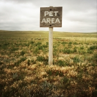 Open spaces and radical changes in the landscape serve as a crash course in US geography. Just off of US 76 in Northeastern Colorado, a handmade sign at a gas station, unintentionally serves as a definitive icon of the Americana road trip.