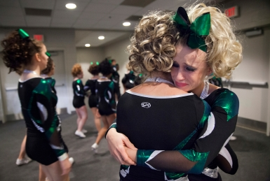"Kelsey Sims, right, a senior on Wilson Memorial High School's cheerleading team, embraces her classmate Taylor Bailey moments after completing their Group 2A state championship winning performance in Richmond on Nov. 8, 2014. ""It's the best and worst feeling I've ever felt in my life,"" said Sims, describing the final performance as perfect but bittersweet as it is her last with the team."