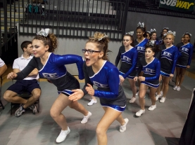 Robert E. Lee High School cheerleaders run out to the competition mat to start their Group 2A cheerleading state championship performance in Richmond on Nov. 8, 2014.