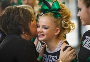 Wilson Memorial High School cheerleading coach Renae Bailey, left, gives one of her athletes, Rachel VanFossen, a kiss on the cheek before their performance in the Group 2A cheerleading championship in Richmond on Nov. 8, 2014.