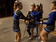 Robert E. Lee High School's Gabby Sansom, who tore her ACL and meniscus in a previous competition, is comforted by her teammates before they started their state finals routine without her in Richmond on Nov. 8, 2014.