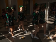 Wilson Memorial High School cheerleaders walk together to the warm up area before their Group 2A cheerleading state championship performance in Richmond on Nov. 8, 2014.
